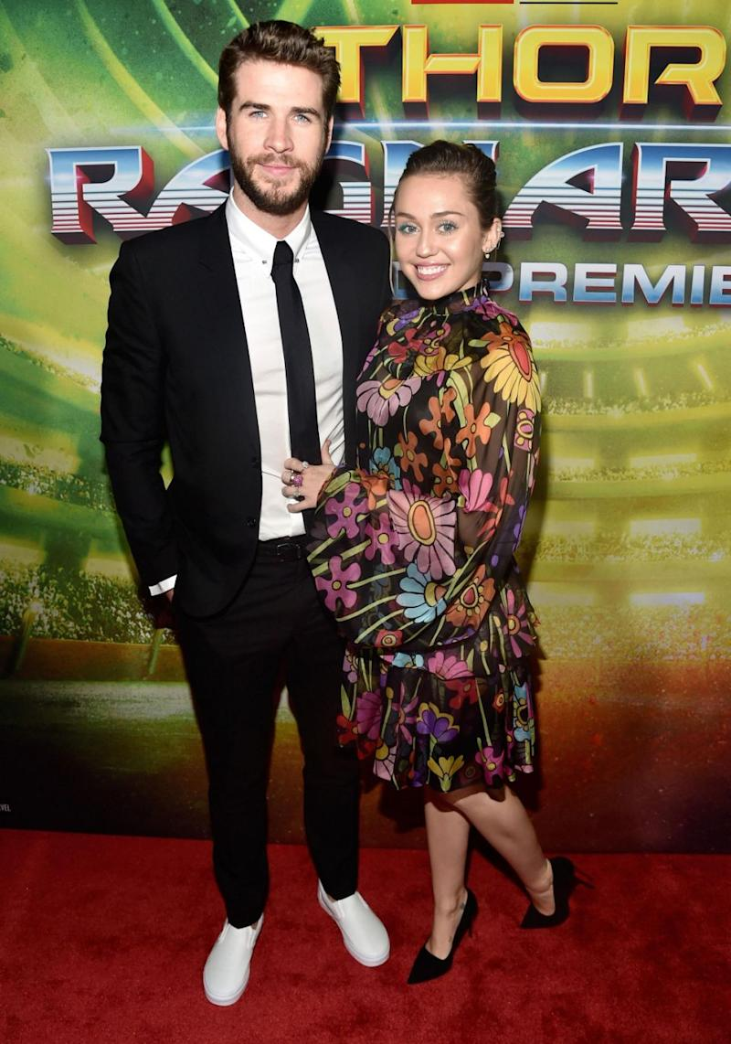 Miley Cyrus was right by her man Liam Hemsworth's side on Tuesday night at the Thor: Ragnarok premiere in Los Angeles. Source: Getty