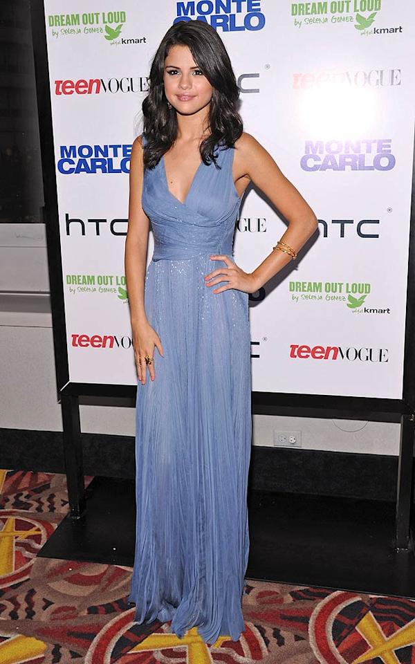 """But Katie wasn't the only """"Monte Carlo"""" cast member in attendance. The movie's lead -- Selena Gomez -- sashayed into the theater in a sophisticated yet chic J. Mendel gown and gold accessories. Mike Coppola/<a href=""""http://www.gettyimages.com/"""" target=""""new"""">GettyImages.com</a> - June 23, 2011"""