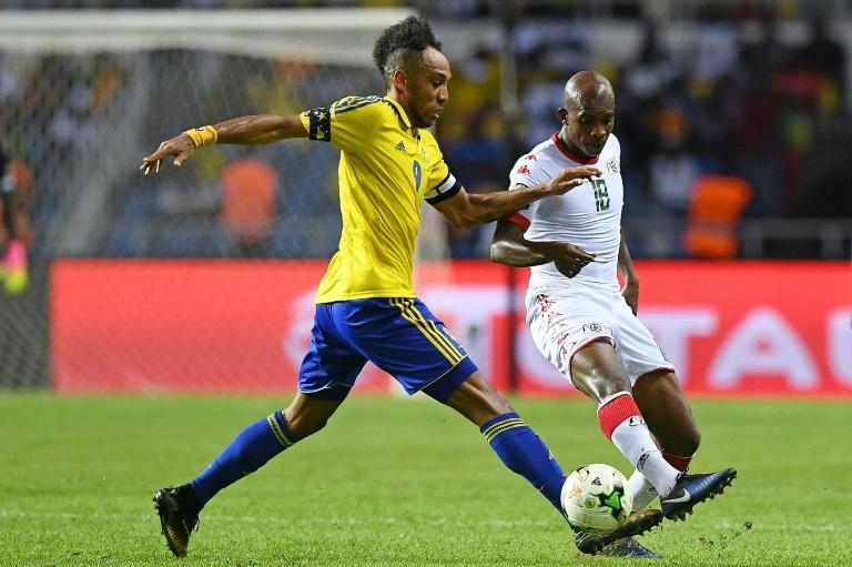 Pierre-Emerick Aubameyang (L) and his Gabon teammates were forced to sleep on an airport floor in the Gambia.