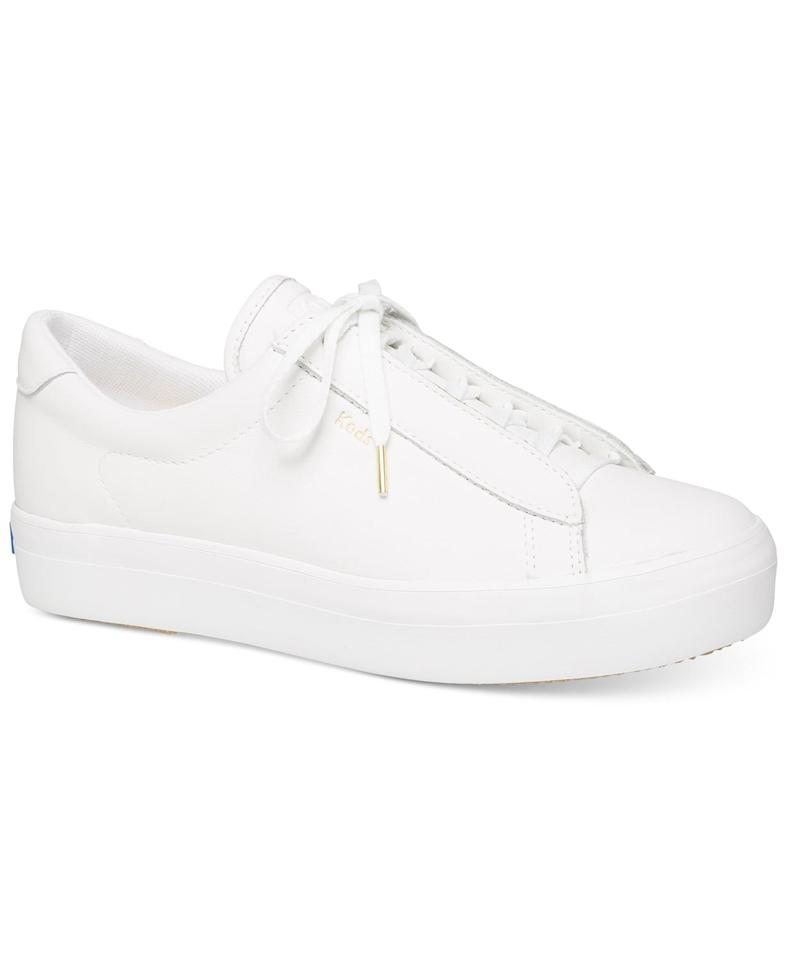 """<p>These classic <a href=""""https://www.popsugar.com/buy/Keds-Rise-Metro-Leather-Sneakers-490926?p_name=Keds%20Rise%20Metro%20Leather%20Sneakers&retailer=macys.com&pid=490926&price=90&evar1=fab%3Aus&evar9=46619030&evar98=https%3A%2F%2Fwww.popsugar.com%2Ffashion%2Fphoto-gallery%2F46619030%2Fimage%2F46619231%2FKeds-Rise-Metro-Leather-Sneakers&list1=shopping%2Cfall%20fashion%2Cshoes%2Csneakers%2Cmacys&prop13=mobile&pdata=1"""" rel=""""nofollow"""" data-shoppable-link=""""1"""" target=""""_blank"""" class=""""ga-track"""" data-ga-category=""""Related"""" data-ga-label=""""https://www.macys.com/shop/product/keds-rise-metro-leather-sneakers?ID=9383196&amp;CategoryID=26499#fn=SHOE_STYLE%3DFashion%20Sneakers%26sp%3D1%26spc%3D1318%26ruleId%3D134%26searchPass%3DmatchNone%26slotId%3D2"""" data-ga-action=""""In-Line Links"""">Keds Rise Metro Leather Sneakers</a> ($90) will go with everything.</p>"""
