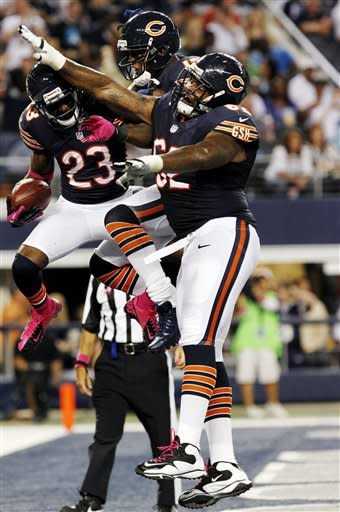 Chicago Bears wide receiver Devin Hester (23) celebrates his touchdown against the Dallas Cowboys with Brandon Marshall (15) and Chilo Rachal (62) during the second half of an NFL football game, Monday, Oct. 1, 2012, in Arlington, Texas. (AP Photo/LM Otero)