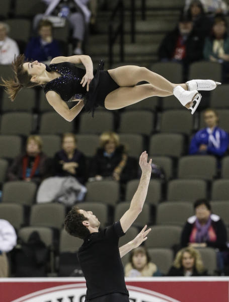 Marissa Castelli and Simon Shnapir compete in the senior pairs short program at the U.S. figure skating championships in Omaha, Neb., Thursday, Jan. 24, 2013. (AP Photo/Nati Harnik)