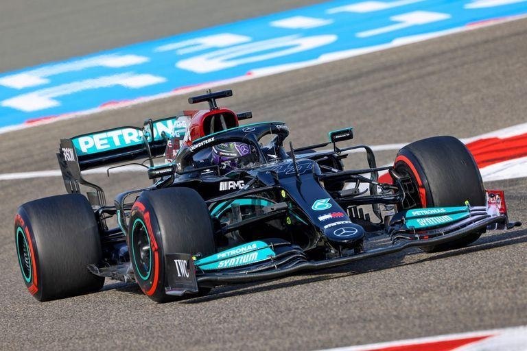 Mercedes' British driver Lewis Hamilton drives during the first practice session ahead of the Bahrain Formula One Grand Prix at the Bahrain International Circuit in the city of Sakhir on March 26, 2021. (Photo by GIUSEPPE CACACE / AFP)
