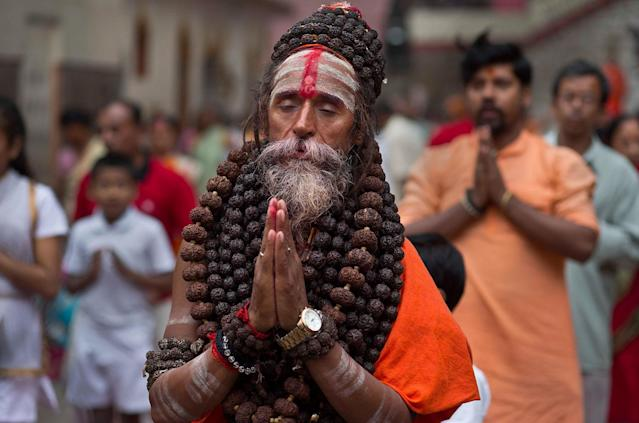 <p>An Indian Sadhu or Hindu holy man performs Yoga as others follow during the International Yoga Day at Kamakhya temple in Gauhati, India, Wednesday, June 21, 2017. (Photo: Anupam Nath/AP) </p>