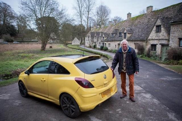 Yellow Vauxhall Corsa with Peter Maddox