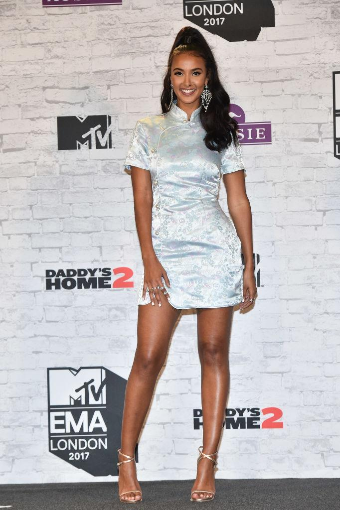<p>Television presenter Maya Jama opted for a dress from Alexa Chung's new label. She accessorised the look with supersized earrings and a high pony. (Photo: Getty Images) </p>