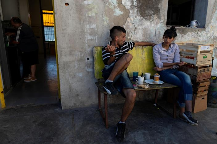 Lucas, 24, a former tuberculosis patient, talks to a colleague during his lunch break at Masantonio Organization in Buenos Aires, Argentina, Jan. 11, 2019. Lucas works for the Masantonio Organization, where he visits tuberculosis patients who have no family, helping them with their TB treatment and recovery. (Photo: Magali Druscovich/Reuters)