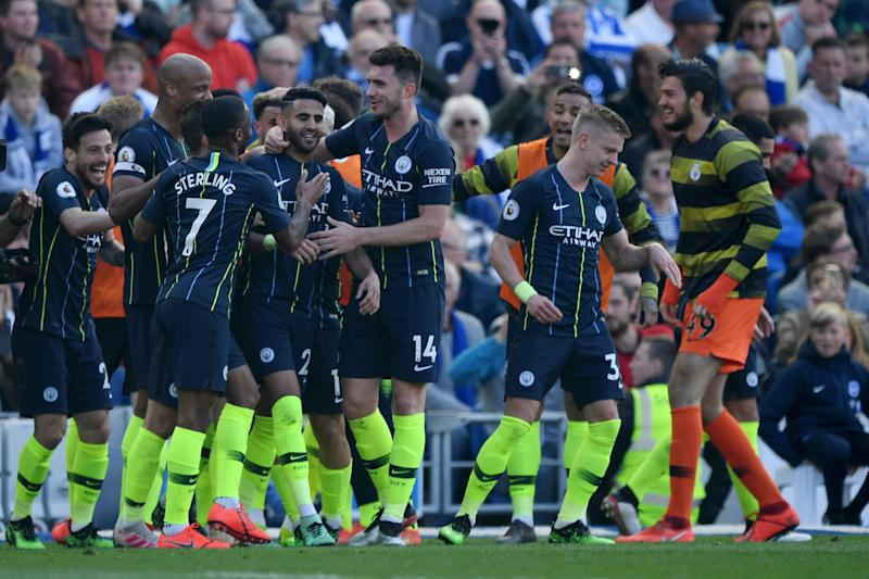 Riyad Mahrez celebrates with teammates after scoring Manchester City's third. (Credit: Getty Images)