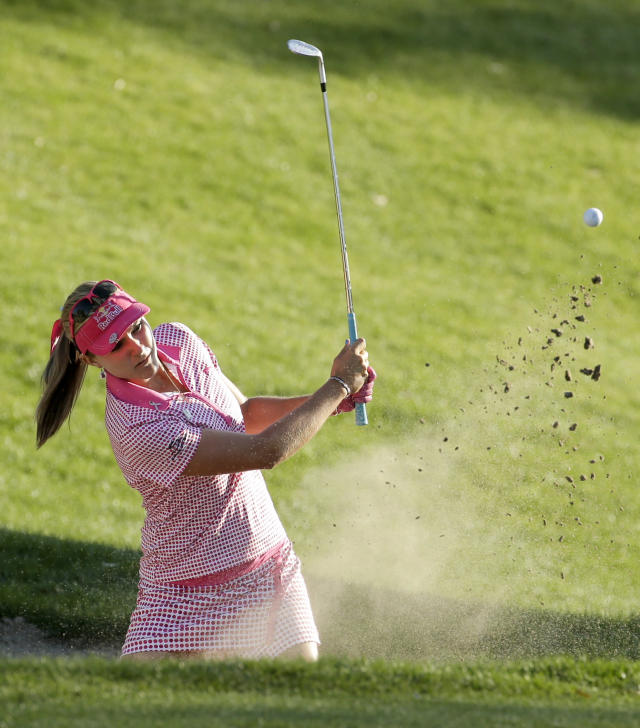 Lexi Thompson watches her bunker shot on the 17th hole during the third round of the Kraft Nabisco Championship golf tournament on Saturday, April 5, 2014, in Rancho Mirage, Calif. (AP Photo/Chris Carlson)