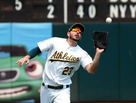 FILE PHOTO: Jul 1, 2018; Oakland, CA, USA; Oakland Athletics left fielder Matt Joyce (23) catches the ball against the Cleveland Indians during the third inning at Oakland Coliseum. Mandatory Credit: Kelley L Cox-USA TODAY Sports