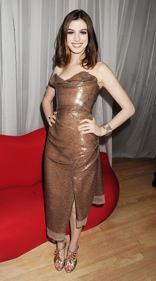 "Anne Hathaway was queen of the night in her figure-hugging Vivienne Westwood gown at the ""Alice in Wonderland"" premiere after party in London. Dave M. Benett/<a href=""http://www.gettyimages.com/"" target=""new"">GettyImages.com</a> - February 25, 2010"