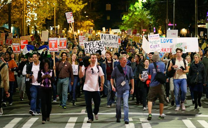 <p>Hundreds of protesters march in downtown Seattle as they protest the election of President-elect Donald Trump, Wednesday, Nov. 9, 2016. A day after Trump's election as president, the divisions he exposed only showed signs of widening as many thousands of protesters flooded streets across the country to condemn him. (Photo: Ted S. Warren/AP) </p>