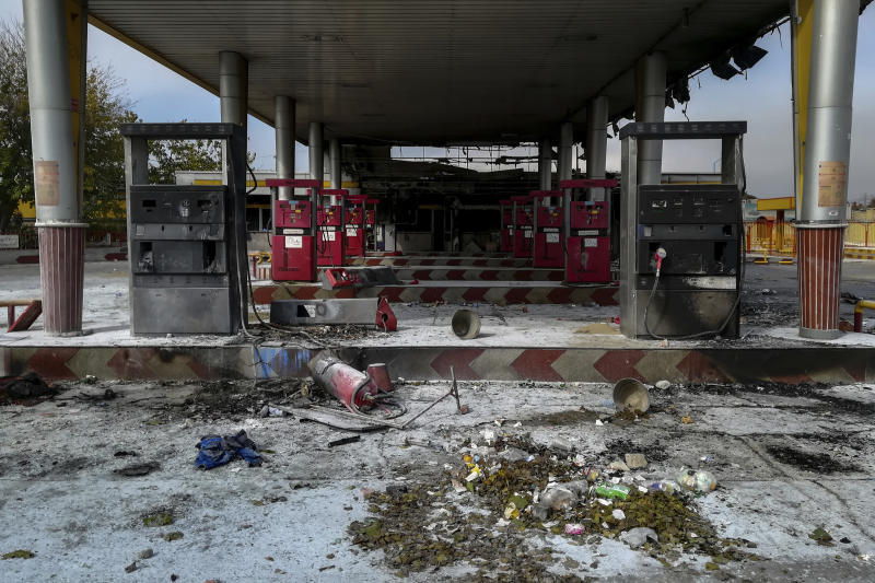 """This photo released by the Iranian Students' News Agency, ISNA, shows a gas station that was burned during protests that followed authorities' decision to raise gasoline prices, in Tehran, Iran, Sunday, Nov. 17, 2019.  Ayatollah Ali Khamenei, Iran's supreme leader on Sunday backed the government's decision to raise gasoline prices and called angry protesters who have been setting fire to public property over the hike """"thugs,"""" signaling a potential crackdown on the demonstrations. (Abdolvahed Mirzazadeh/ISNA via AP)"""
