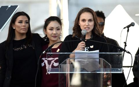 Eva Longoria, Constance Wu and Natalie Portman speak onstage at 2018 Women's March Los Angeles at Pershing Square  - Credit: Amanda Edwards/Getty Images