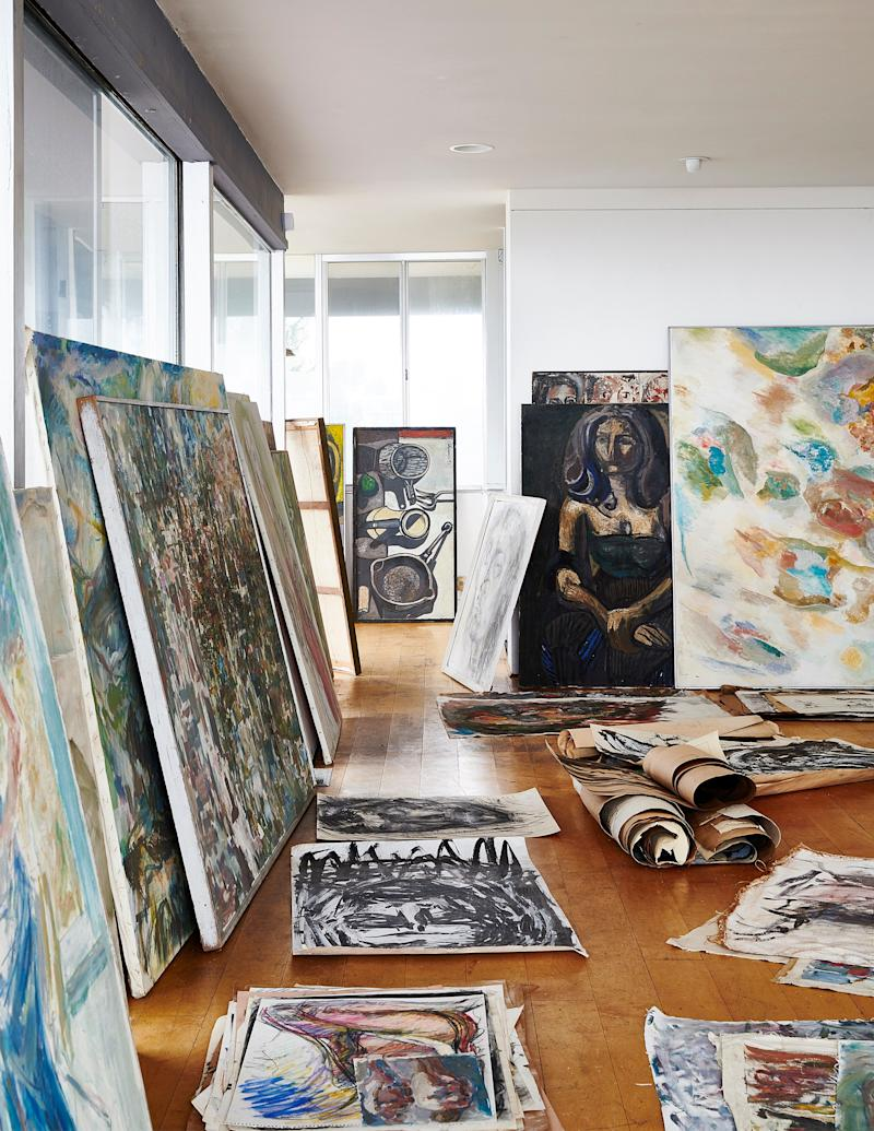 Along with the house itself, the developers purchased the more than 200 paintings of Robert Chuey's estate. The light-filled house had doubled as his studio.