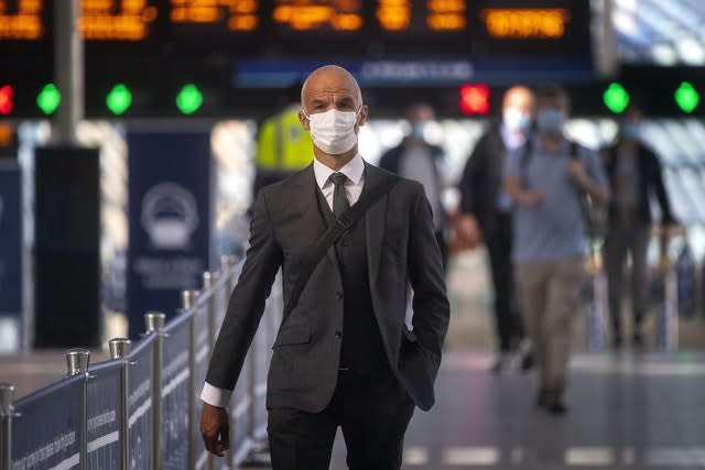 Passengers wearing face masks at Waterloo station