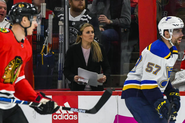 FILE - In this March 8, 2020, file photo, broadcast team member Kendall Coyne Schofield works during the first period of an NHL hockey game between the Chicago Blackhawks and the St. Louis Blues, in Chicago. The Professional Womens Hockey Players Association enters its second season with plans to regionalize its structure by basing players in five hub cities, while also continuing its Dream Gap Tour series of barn-storming stops across North America. The new structure provides players with a more professional training environment on a regular basis, which will allow us to put the best product of womens professional hockey on the ice daily, two-time U.S. Olympian and PWHPA board president Kendall Coyne Schofield said in a released statement. (AP Photo/Matt Marton, File)