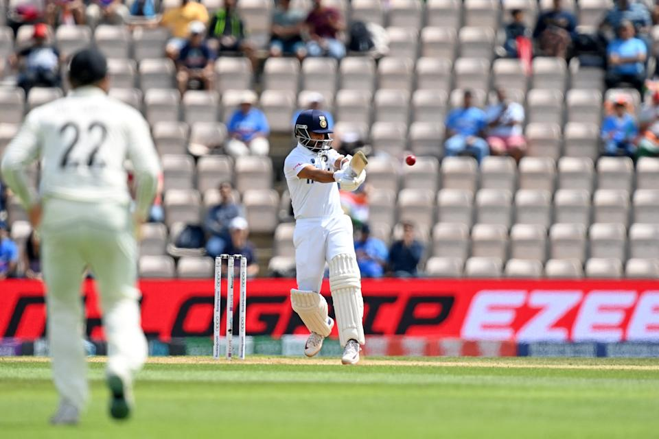 India's Ajinkya Rahane plays a shot on the final day of the ICC World Test Championship Final between New Zealand and India at the Ageas Bowl in Southampton, southwest England on June 23, 2021. - RESTRICTED TO EDITORIAL USE (Photo by Glyn KIRK / AFP) / RESTRICTED TO EDITORIAL USE (Photo by GLYN KIRK/AFP via Getty Images)