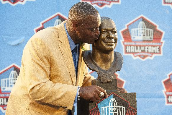 Former NFL linebacker Derrick Brooks with his bust during the NFL Class of 2014 Pro Football Hall of Fame Enshrinement Ceremony at Fawcett Stadium on August 2, 2014 in Canton, Ohio