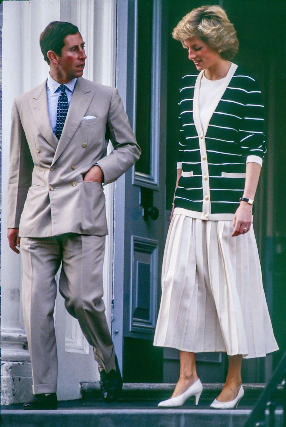 <p>Princess Diana paired a black-and-white striped, gold-buttoned sweater with a long pleated skirt to drop off Prince William at school alongside Prince Charles.<br></p>