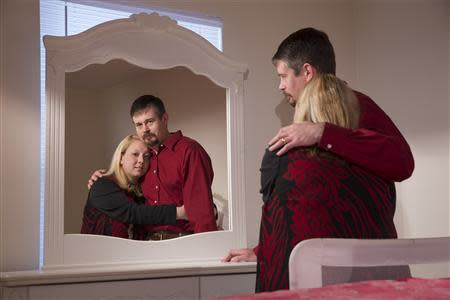 Amanda and Bryan Alexander stand in their adopted daughter's bedroom in Fort Oglethorpe, Georgia, February 15, 2014. REUTERS/Christopher Aluka Berry