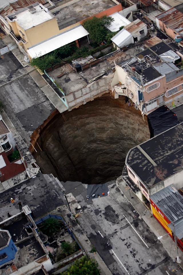 A bird's-eye view of the giant sinkhole which swallowed a 3-storey building after it opened up in Guatemela City last year.