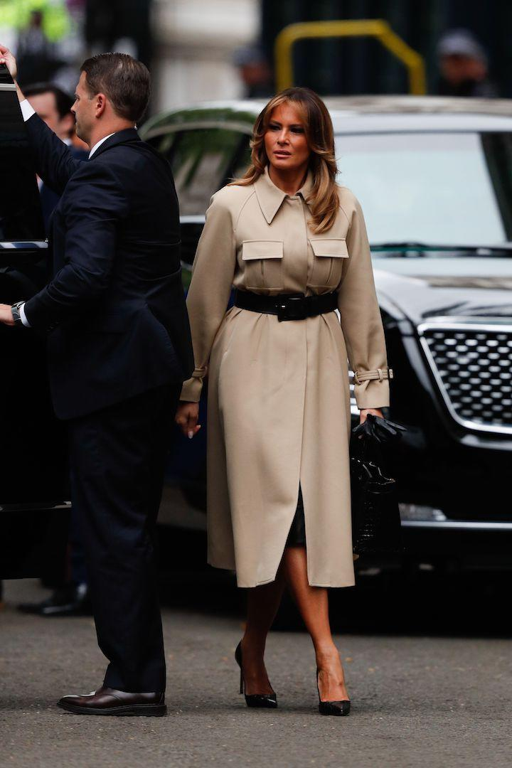 For a meeting with Prime Minister Theresa May on the second day of the UK state visit, Melania Trump dressed for the British rain in a belted trench coat by Céline she's worn before. The First Lady finished the camel number with the controversial Manolo Blahnik heels she wore to help out with the Hurricane Harvey relief efforts and a matching Hermès bag. [Photo: Getty]
