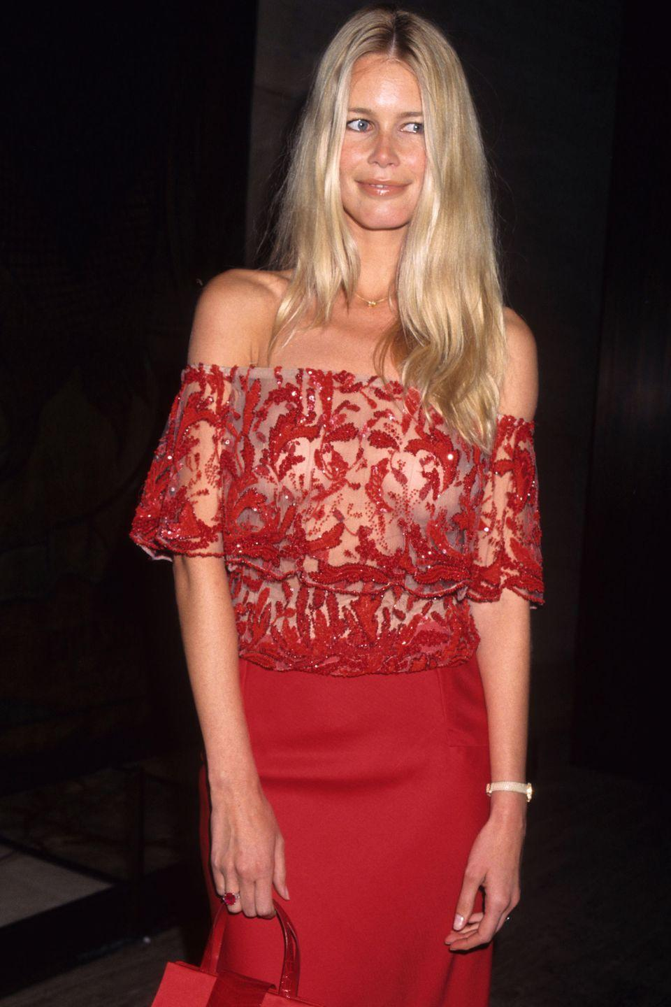 <p>Off to a Valentino party at the Four Seasons Restaurant in New York, on June 14th 2000 wearing an incredibly elegant, Valentino dress in his iconic red, with the most beautiful off the shoulder layered lace sleeves and bodice.</p>