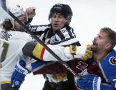 Linesman Mark Shewchyk (92) tries to break up a fight between Vegas Golden Knights right wing Mark Stone (61) and Colorado Avalanche right wing Joonas Donskoi (72) in the third period of Game 1 of an NHL hockey Stanley Cup second-round playoff series Sunday, May 30, 2021, in Denver. (AP Photo/Jack Dempsey)