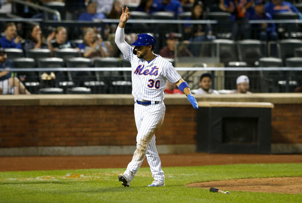 New York Mets Michael Conforto reacts after scoring against the Atlanta Braves in the seventh inning of a baseball game. Wednesday, June 23, 2021, in New York. (AP Photo/Noah K. Murray)