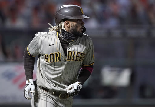 San Diego Padres' Fernando Tatis Jr. watches his two-run home run against the San Francisco Giants during the first inning of the second game of a baseball doubleheader Friday, Sept. 25, 2020, in San Francisco. (AP Photo/Tony Avelar)