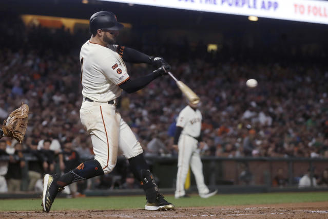 San Francisco Giants' Kevin Pillar hits a double to score Evan Longoria against the Oakland Athletics during the sixth inning of a baseball game in San Francisco, Tuesday, Aug. 13, 2019. (AP Photo/Jeff Chiu)