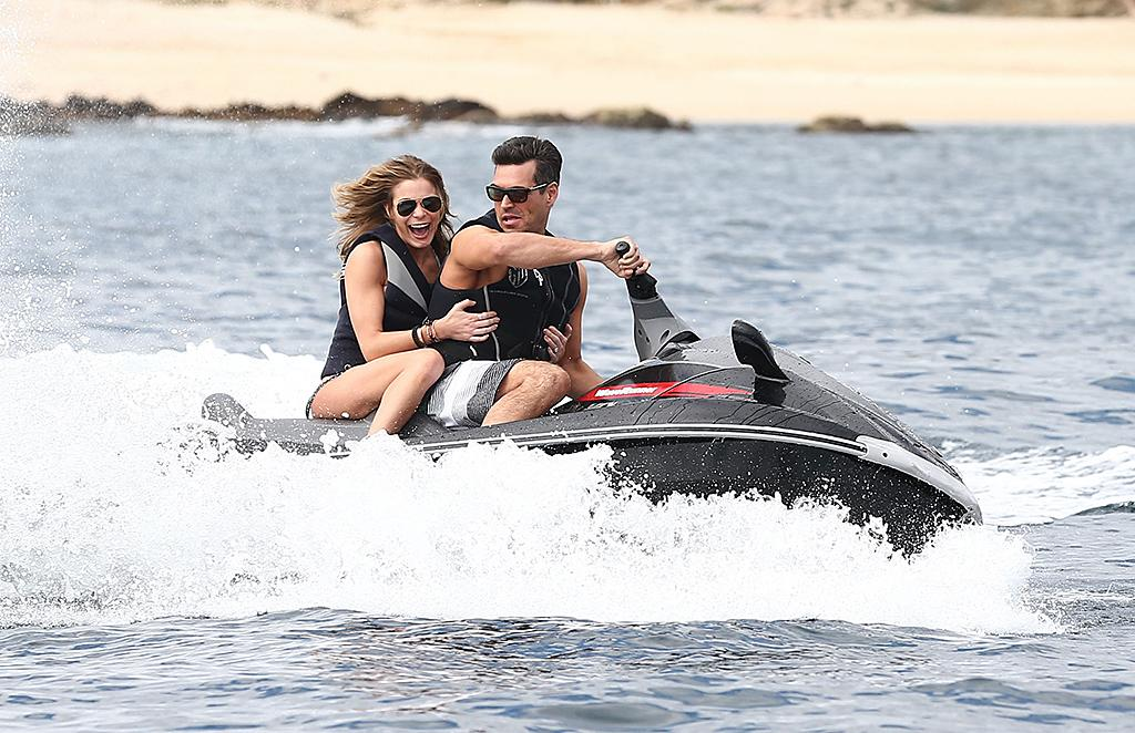 "*EXCLUSIVE* Cabo San Lucas, Mexico - LeAnn Rimes and husband Eddie Cibrian continue their holiday vacation and take Wave Runner water crafts out for some fun of the ""Polly"" yacht in Mexico.  Eddie zipped around the waters while LeAnn held on for dear life, getting a big thrill with her hubby.  After their playful water sporting, LeAnn took a deep sea dive to cool off before having lunch on the yacht.