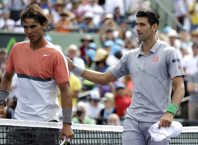 Rafael Nadal, left, of Spain, meets Novak Djokovic, right, of Serbia, at the net after Djokovic won 6-3, 6-3 in the men's final at the Sony Open Tennis tournament on Sunday, March 30, 2014, in Key Biscayne, Fla. (AP Photo/Lynne Sladky)