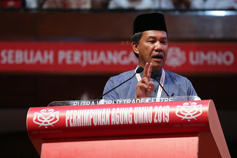 Umno deputy president Datuk Seri Mohamad Hasan speaks at the opening of the Woman, Youth and Puteri wings during the 2019 Umno General Assembly at the PWTC in Kuala Lumpur December 4, 2019. — Picture by Yusof Mat Isa