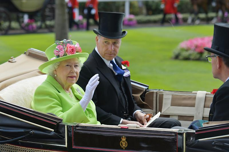 Queen Elizabeth II and David Armstrong-Jones, Earl of Snowdon arrive in the Royal procession on day 4 of Royal Ascot at Ascot Racecourse on June 22, 2018 in Ascot, England.