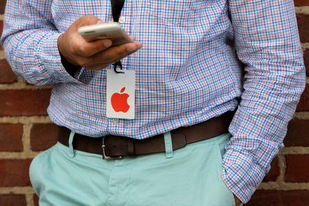 A man uses his iPhone before a preview event at the new Apple Store Williamsburg in Brooklyn, New York, U.S., July 28, 2016.  REUTERS/Andrew Kelly
