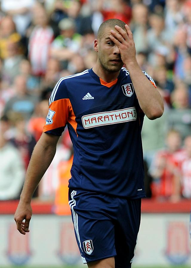 Fulham's Pajtim Kasami gestures after Fulham are relegated after losing 4-1 to Stoke City during the English Premier League soccer match between Stoke City and Fulham at the Britannia Stadium in Stoke On Trent, England, Saturday May 3, 2014. (AP Photo/Rui Vieira)