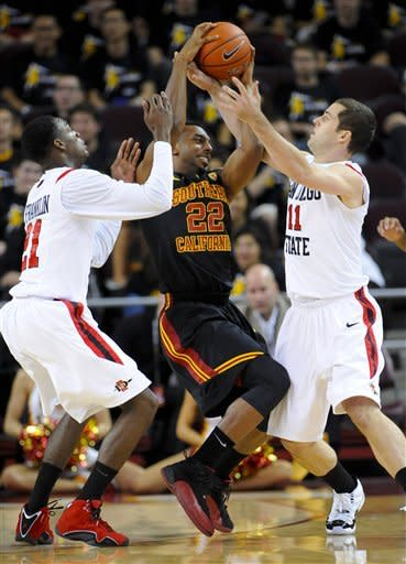 San Diego State guard Jamaal Franklin, left and guard James Rahon (11) double team USC guard Byron Wesley (22) during the first half of an NCAA college basketball game, Sunday, Nov. 25, 2012, in Los Angeles. (AP Photo/Gus Ruelas)
