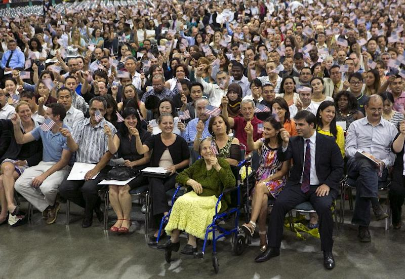 New American Khatoun Novasartian Khoykani, a 99-year-old woman from Iran sitting in wheel chair, with nearly 7,500 people becoming U.S. Citizens at the L.A. Convention Center in Los Angeles Friday, July 26, 2013. On Friday, Khoykani became the oldest person this year to join the small group of naturalized citizens over the age of 95. Each year, less than ten people older than 95 become citizens in Los Angeles, according to U.S. Citizenship and Immigration Services. Only 27 people older than 100 have become citizens in the past 50 years. (AP Photo/Damian Dovarganes)