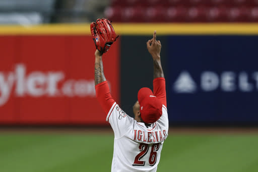 Cincinnati Reds' Raisel Iglesias reacts to the final out in the team's baseball game against the Pittsburgh Pirates in Cincinnati, Wednesday, Sept. 16, 2020. The Reds won 1-0. (AP Photo/Aaron Doster)