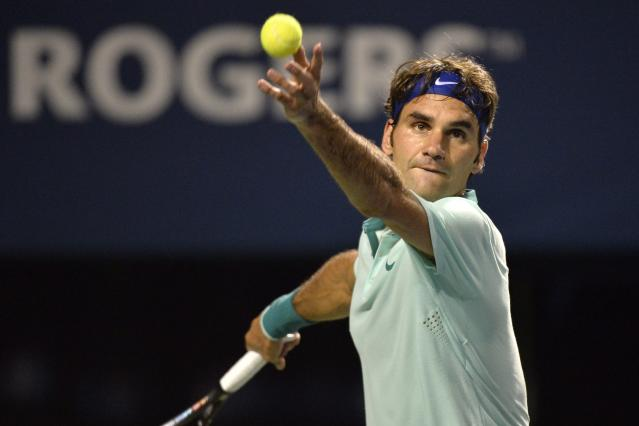 Roger Federer, of Switzerland, serves to David Ferrer, of Spain, during the Rogers Cup tennis tournament in Toronto, Friday, Aug. 8, 2014. (AP Photo/The Canadian Press, Nathan Denette)