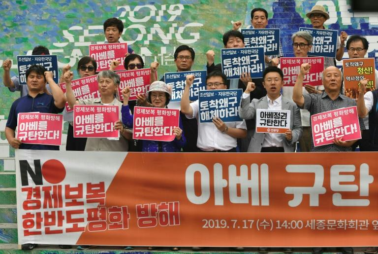 The trade spat has sparked ire in South Korea, where almost seven in 10 people still report negative feelings towards the country's former colonial ruler (AFP Photo/Jung Yeon-je)