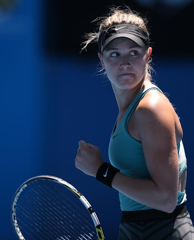 Eugenie Bouchard of Canada celebrates a point won against Ana Ivanovic of Serbia during their quarterfinal at the Australian Open tennis championship in Melbourne, Australia, Tuesday, Jan. 21, 2014.(AP Photo/Aaron Favila)