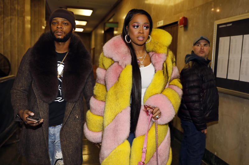 """Rapper Remy Ma, whose real name is Reminisce Smith, leaves Manhattan criminal court, with husband Shamele Mackie, whose stage name is Papoose, in New York, Monday, Dec. 2, 2019. She's accused of punching her """"Love & Hip Hop New York"""" co-star Brittney Taylor in the face during an April 16 concert at Irving Plaza, in Manhattan. (AP Photo/Richard Drew)"""