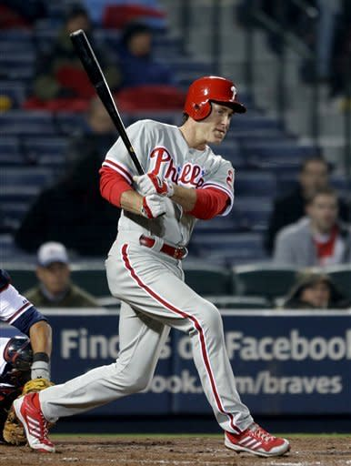 Philadelphia Phillies' Chase Utley swings for a foul ball in the fourth inning of a baseball game against the Atlanta Braves, Thursday, April 4, 2013, in Atlanta. (AP Photo/David Goldman)