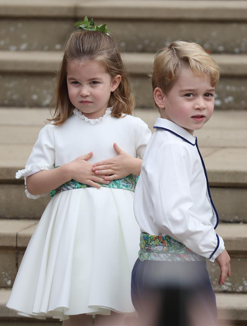 Princess Charlotte and Prince George arrive for the wedding of Princess Eugenie to Jack Brooksbank at St George's Chapel in Windsor Castle. PRESS ASSOCIATION Photo. Picture date: Friday October 12, 2018. See PA story ROYAL Wedding. Photo credit should read: Steve Parsons/PA Wire