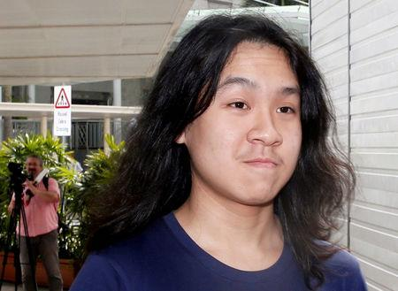 FILE PHOTO: Teen blogger Amos Yee arrives at the State Courts in Singapore