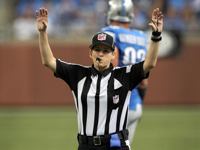 NFL replacement Field Judge Shannon Eastin blows her whistle after throwing a penalty flag during the first half of the NFL football game between the Detroit Lions and St. Louis Rams in Detroit, Michigan September 9, 2012.