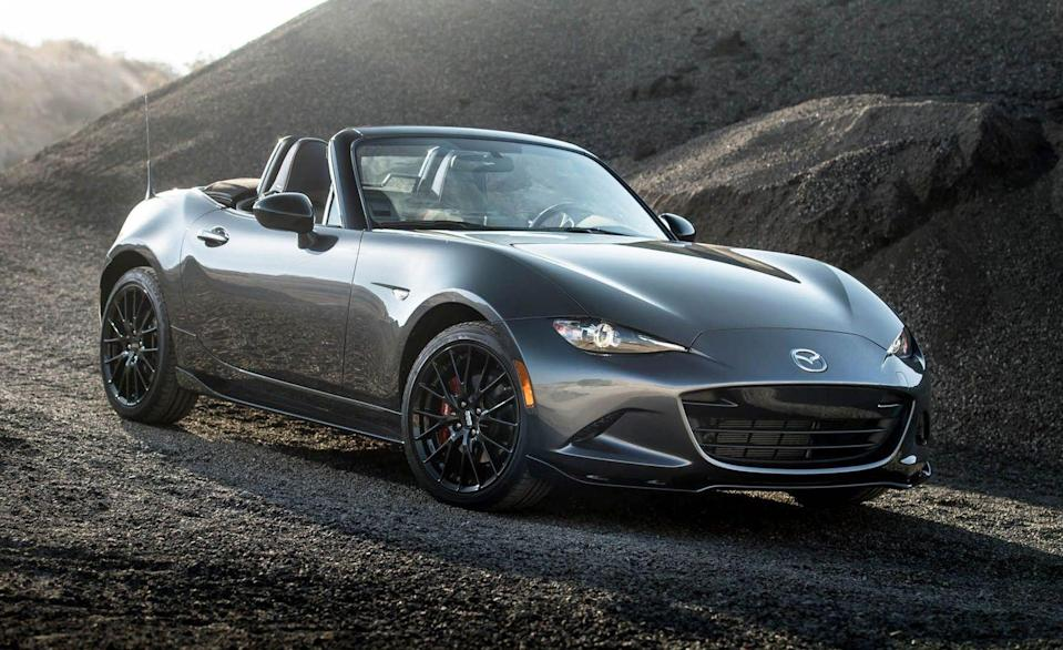 """<p>Though its platform mate, the Fiat 124, has been euthanized, the fourth-generation <a href=""""https://www.caranddriver.com/mazda/mx-5-miata"""" rel=""""nofollow noopener"""" target=""""_blank"""" data-ylk=""""slk:Mazda Miata"""" class=""""link rapid-noclick-resp"""">Mazda Miata</a> not only lives on but remains resolutely faithful to the rear-wheel drive sports car's original format, which includes a manual transmission. Both the two-seat roadster version and the RF (for """"retractable fastback"""") are offered with the choice of a six-speed manual or an automatic across all trim levels. </p>"""